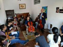 "The Internationally recognized Project ""Starving Artist Prevention"".  Here in artistic collaboration with the young musicians of 'Luzes da Ribalta', in Brazil."