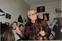 Vladimir Yeshayavitch Novak during the numerous student recitals in our home, surrounded by children and youth of all ages from immigrant families.